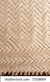 Detail of an African  woven bag made to extract coconut juice. It is made from coconut palm leaves.