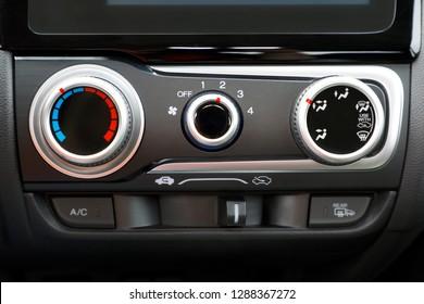 detail air conditioning button inside a car