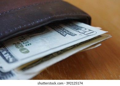 Detail of the American money (USD, US, US dollars), bank notes inserted in the leather wallet