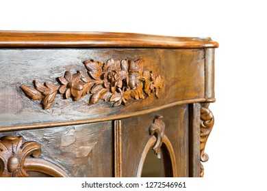 Detail of an ancient italian wooden furniture of the 19th century just restored on white background for easy selection