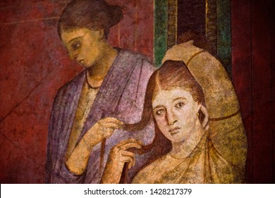 detail of the ancient painting in the Villa of the Mysteries in Pompeii. Pompeii was destroyed by the volcanic eruption in 79 BC