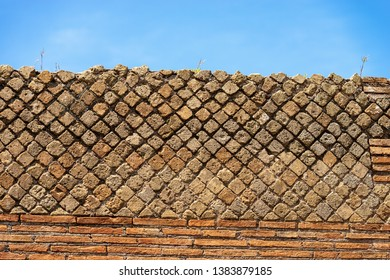 Detail of an ancient Roman brick wall in Ostia Antica, Roman colony founded in the 7th century BC. near Rome, UNESCO world heritage site. Latium, Italy, Europe