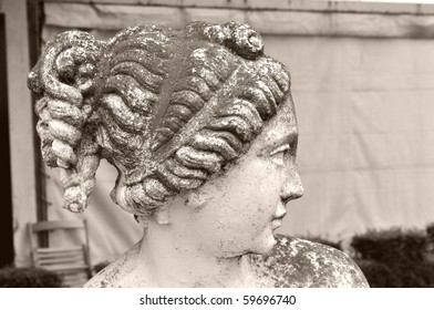 Detail of an ancient statue of a girl