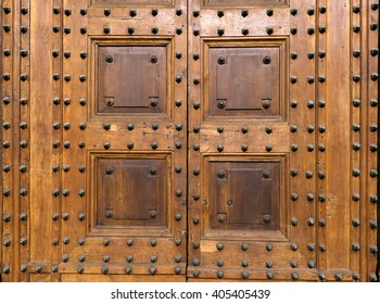 Detail of an ancient wooden door with metallic studs. Pistoia Cathedral, Tuscany, Italy