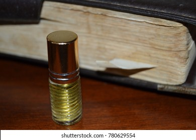 Detail of anointing oil and holy bible.