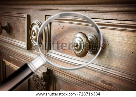 Detail of an antique wooden italian furniture just restored with a  magnifying glass on foreground looking - Detail Antique Wooden Italian Furniture Just Stock Photo (Edit Now