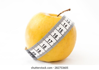 Detail of an apple with a tape measure