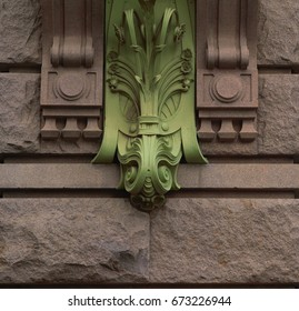 Detail of architecture, green metal curls on the house