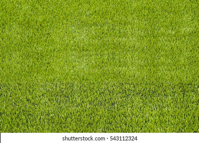 The detail of artificial green grass soccer field for backgroud texture