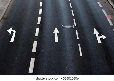 detail of asphalt surface with traffic symbols