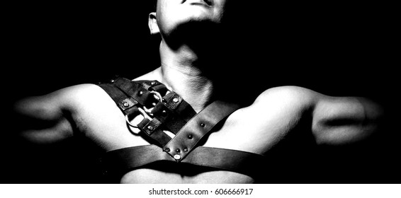 Detail of athletic man harness with spikes