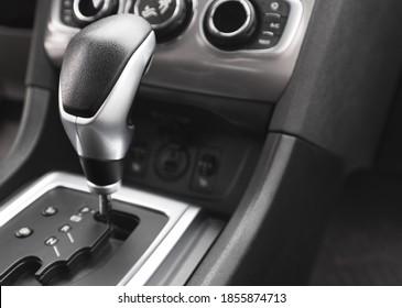 Detail of an automatic gear shifter in a new, modern car. Modern car interior.
