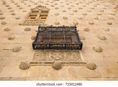 Detail of Balcony in Facade of Casa de las Conchas in Salamanca, Spain, covered in scalloped shells, Community of Castile and León, Spain.  Declared a UNESCO World Heritage Site in 1988