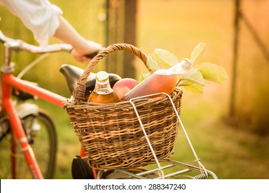 Detail of the basket with fresh food on the bike. Color toned image.