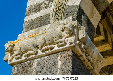 Detail of bas-relief depicting two cows on the column of the Basilica of the Santissima Trinità  of Saccargia (Sassari, Sardinia, Italy), evidence of architecture in Pisan Romanesque style, in spring.