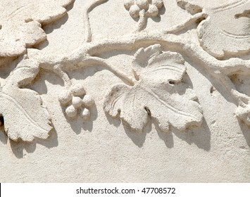 detail of bas-relief over stone showing grapevine leafs an fruits