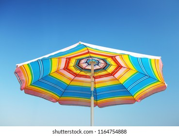 Detail of beach parasol at blue sky