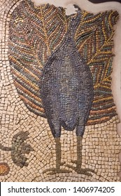 Detail of a beautiful ancient mosaic in Aquileia (Italy) with a peacock making his wheel