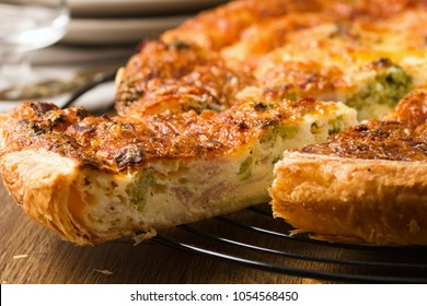 Detail of beautiful and delicious looking slice of quiche being served
