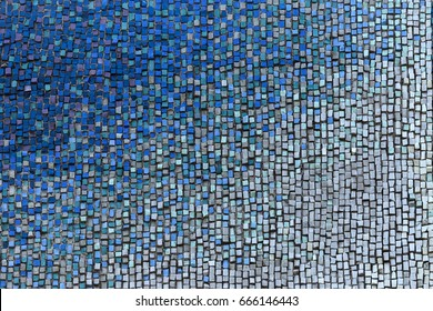 Detail of beautiful old collapsing abstract ceramic mosaic adorned building. Venetian mosaic as decorative background. Selective focus. Abstract  Pattern. Abstract  colored  ceramic stones
