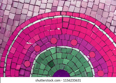 Detail of a beautiful old crumbling abstract ceramic mosaic decorated building. Venetian mosaic as a decorative background. Selective focus. Abstract pattern. Abstract mosaic colored ceramic stones