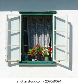detail of beautiful rustic window with flowers