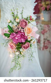 Detail of the beautiful wedding dress with flowers