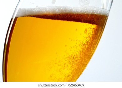 Detail of Beer Glass on the Blue Background. Bottom View.