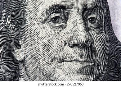 Detail of Benjamin Franklin on a U.S. 100 dollar bill.