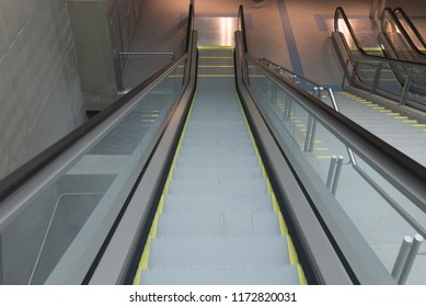Detail of big escalator on descend angle view