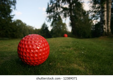 Detail of big red golf ball
