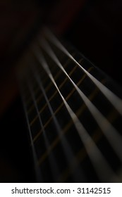 Detail of a black acoustic guitar in black