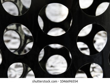 Detail of black circles in a black and white photography