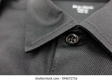 Detail of black polo shirt