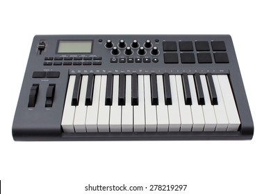 Detail of black and white keys on Axiom 25 MIDI music keyboard  isolated on white with room for your text. Music is loved by people and animals around the world and is as old as man kind.