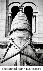 Detail in black and white of a turret of the Sache Coeur basilica in Paris, France, with a slight vignette effect.