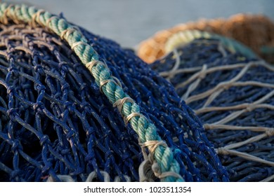 detail of a blue fishing net at the north sea coast