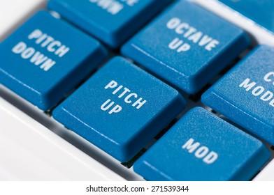 Detail of blue keys on music keyboard.