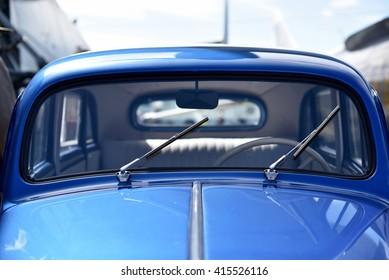 Detail of blue vintage car. (Identity, vintage, unique - concept)