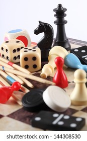 Detail of board games, pawns, chessmen, mikado and dices
