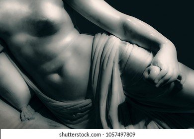 Detail body woman on bed sculpture isolated photo on dark background