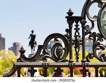 Detail of Boston Public Garden gate, George Washington statue in background