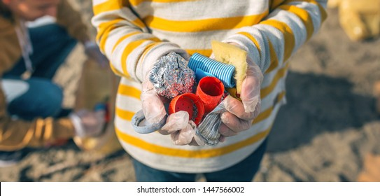 Detail of boy hands with garbage collected from the beach