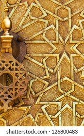 Detail of the brass door and knocker at the royal palace in Fez, Morocco. Islamic design and pattern.