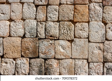 Detail of the bricks of a dry stone wall at the Uxmal archaeological site, Yucatan, Mexico.
