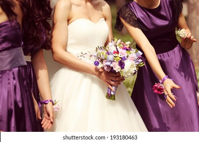Detail and bride and bridesmaid with flowers