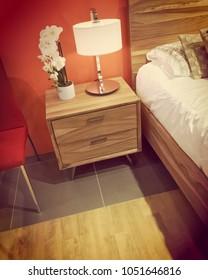 Detail of a bright contemporary bedroom in warm orange tones.