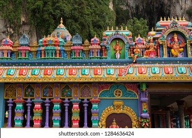 Detail of brightly coloured architecture surrounding the entrance to Temple Cave, part of the Batu Caves site at Gombok, near Kula Lumpur, Malaysia