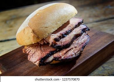 Detail of Brisket Sandwich on wooden cutting board