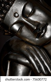 Detail of the bronze statue of sleeping Buddha